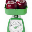 Green scale weighing apples — Stock Photo