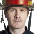 Stock Photo: handsome firefighter