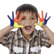 Happy boy with colorful painted hands — Stock Photo