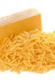 Grated bar of cheddar cheese — Stock Photo