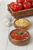 Grated cheese and salsa bowl — Stock Photo
