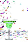 Green drink in martini and confetti in background — Stock Photo