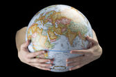 Hand carrying globe — Stock Photo