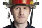 Handsome firefighter — Stock Photo