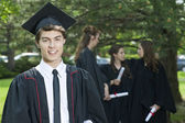 Handsome man on his graduation day — Stock Photo