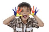 Happy boy barevné malované rukama — Stock fotografie