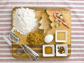 Overhead view of cake ingredient with cookie cutter candy cane a — Stock Photo
