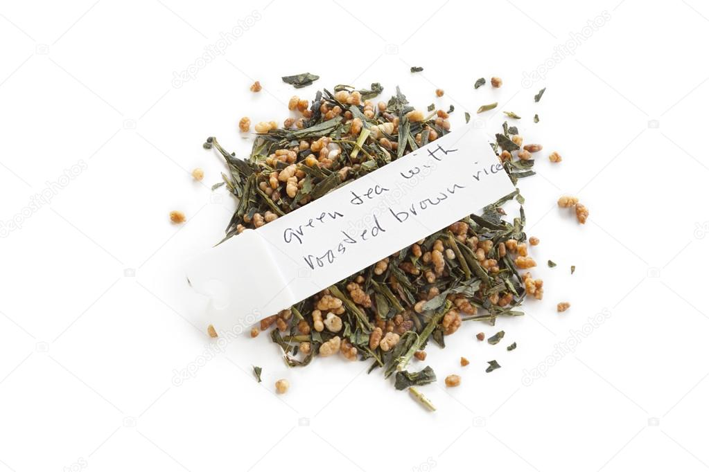 Green tea with roasted brown rice — Stock Photo #14091792