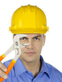 Businessman with yellow hard hat — Stock Photo