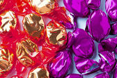 Close up shot of golden and purple hard candies — Foto de Stock