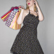 Beautiful young lady  with shopping bag - Stockfoto