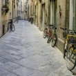 Royalty-Free Stock Photo: Bicycles parked on the street in tuscany