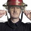 Fireman holding his helmet — Stock Photo