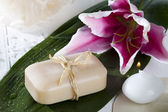 Bar of soap and flower — Stock Photo