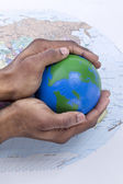 Globe on the hand — Stockfoto