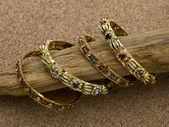 Golden bracelets with stones — Stock Photo