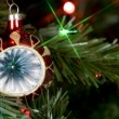 Hanging ornament in a christmas tree - Lizenzfreies Foto