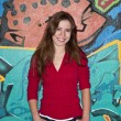 Happy teenage girl with hands in pockets — Stockfoto #17205797