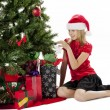 Happy young girl touching christmas tree — Stock Photo #17206623