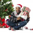 Happy young man with his christmas gift - Foto Stock