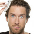 Man with ice bag on his head — Stockfoto