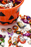Halloween bucket with all sorts of treats — Stock Photo