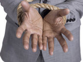 Hand tied up with rope — Stock Photo