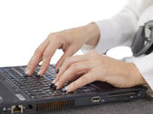 Hands of a typing woman — Stock Photo