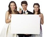 Happy teenager holding white board on prom — Stock Photo