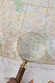 Map and magnifying glass — Stock Photo