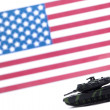 Stock Photo: Military tracked vehicle in front of usflag