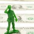 One dollar bill and military toy — Stock Photo #17216453