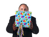 Mature businessman with a gift pack — Stock Photo