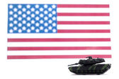 Military tank guarding the american flag — Stock Photo