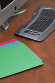 Office table with computer and folder — Stock Photo