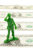 One dollar bill and military toy — Stock Photo
