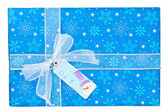 Detailed shot of a blue christmas gift box with snowman sticker — Stock Photo
