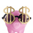 Dollar glasses and piggy bank — Stock Photo