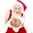 Ecstatic young womlooking at christmas cookies — Stock Photo #17360671