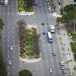 Elevated view of junction with vehicles and trees — Stock Photo