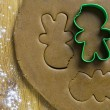 Gingerbread cookie cutter on dough - Stock Photo