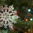 Royalty-Free Stock Photo: Festive snowflake in a christmas tree