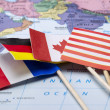Stock Photo: Flags and world map