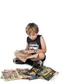 Elementary boy reading a comic book — Stock Photo