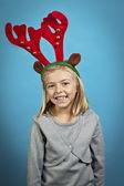 Chica con cuernos de reno — Foto de Stock