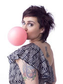Female blowing a bubble — Stock Photo