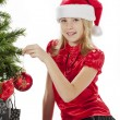 Portrait of girl touching christmas tree — Stock Photo #17435979
