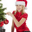 Stock Photo: Portrait of a girl touching christmas tree