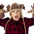 Portrait of playful showing his reindeer gloves — Stock Photo #17436271