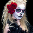 Portrait shot of a young woman wearing sugar skull make up — Stock Photo